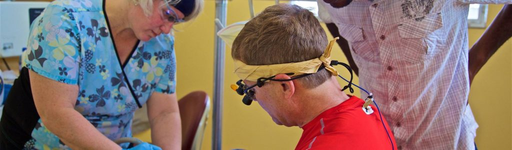 Dr. Tom Bieber performs oral surgery on a dental mission trip