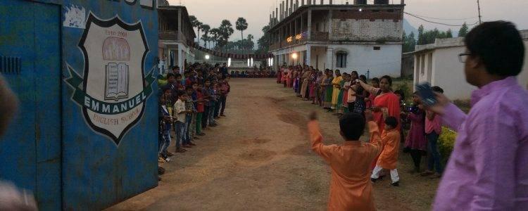 Children line the street near Emmanuel Boarding School in India