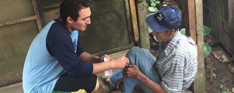 Missionary trip volunteer helps local elderly man