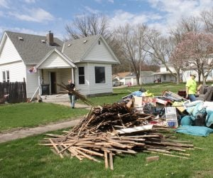 Disaster response volunteer removes debris