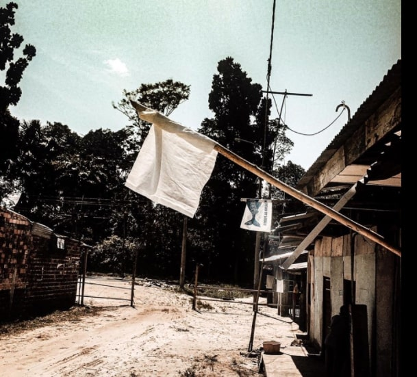 A white flag on a house during coronavirus in Peru